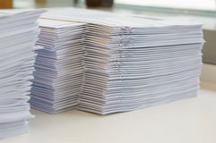 Stack of papers worksheet. Stack of white papers sheet was organized  on office background Royalty Free Stock Photo