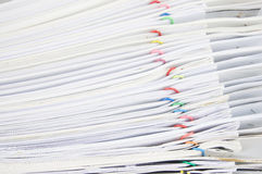 Stack paperwork with colorful paper clip overlap old report. Of sales and receipt Stock Photos