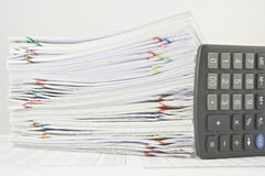 Stack paperwork of sales and receipt with calculator Stock Photo