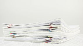 Stack paperwork on table time lapse stock video