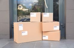 Stack of parcel boxes on floor. Near entrance stock photo