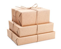 Stack of parcel wrapped with brown packing paper Royalty Free Stock Photos