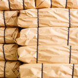 Stack of parcel wrapped in brown recycled paper Stock Photography