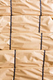 Stack of parcel wrapped in brown recycled paper Stock Image