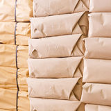 Stack of parcel wrapped in brown recycled paper Stock Images