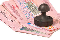 Stack of passports and stamp Royalty Free Stock Image