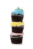A stack of pastel cupcakes on a white background Royalty Free Stock Image
