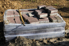 Stack of pavement slabs is ready for usage placed at constru Royalty Free Stock Images