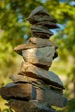 Stack Peace Stones. Peacful zen stack of balancing symbolic stones in woods stock photography