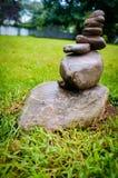 Stack Peace Stones. Peacful zen stack of balancing symbolic stones in yard stock image