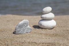 Stack of pebble stones on balance on beach Stock Image
