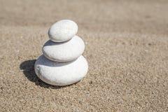 Stack of pebble stones on balance on beach Royalty Free Stock Photo