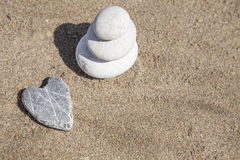 Stack of pebble stones on balance on beach Stock Photos