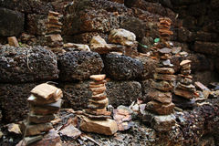 Stack of pebble towers on Laterite stone Royalty Free Stock Image
