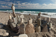 Stack of pebbles balancing on a beach Stock Images