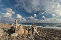 Stack of pebbles balancing on a beach Royalty Free Stock Image