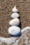 Stack of pebbles. On a big rock at the beach Stock Images