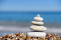 Stack of pebbles on a big rock at the beach Stock Image