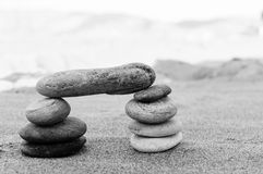 A stack of pebbles in black and white, arch shape, zen concept Royalty Free Stock Photo