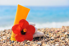 Stack of pebbles, cream and flower at the beach Stock Image