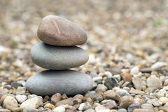 Stack of pebbles. On a floor of gravel Stock Photography