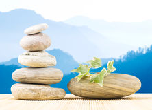 Stack pebbles in front of mountains, Zen concept. Royalty Free Stock Photo