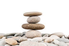 Stack of pebbles isolated Stock Images
