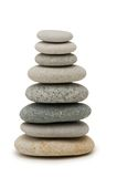 Stack of pebbles isolated. On the white Stock Photo