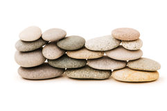 Stack of pebbles isolated. On the white background Royalty Free Stock Photo