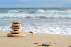 Stack of pebbles at the sea coast Stock Photography