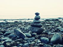 Stack of pebbles. On the shore of lake lago di Garda Stock Photography