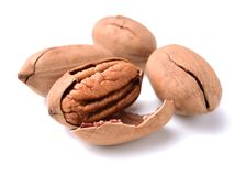 Stack of pecan nuts. Isolated on white background Royalty Free Stock Photos