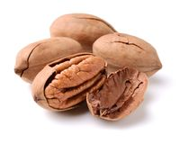 Stack of pecan nuts. On a white background Royalty Free Stock Photos