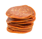 Stack of pepperoni on white background stock photo