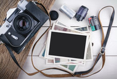 Stack of photos and old camera Stock Photo