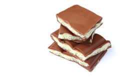 Stack of pieces porous white and dark chocolate Royalty Free Stock Photos