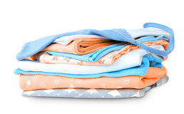 Stack pile folded cotton clothes on white. Royalty Free Stock Image