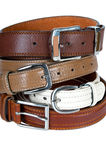 Stack pile of leather belts. On white Royalty Free Stock Image
