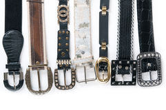 Stack pile of leather belts Stock Photo
