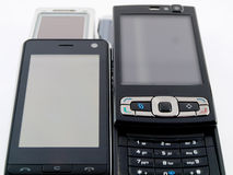 Stack Pile of Several Modern Mobile Phones PDA Stock Photography