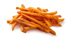 Stack or pile of spicy sweet potato french fries. Or chips on white background stock images