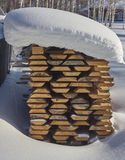 Stack, pile under snow Royalty Free Stock Photography