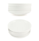 Stack pile of white ceramic plate dishes Stock Photos