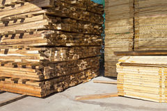 Stack of pile wood bar in lumber yard factory use for constructi Stock Photos