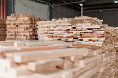 Stack of pile of wood in different dimension. Stack of wood in warehouse in a furniture manufacture production royalty free stock photos