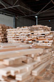 Stack of pile of wood in different dimension. Stack of wood in warehouse in a furniture manufacture production royalty free stock image