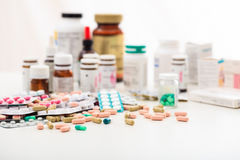 Stack of pills and containers on white background Stock Photos