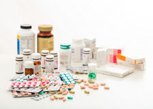 Stack of pills and containers on white background Stock Photo
