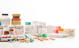 Stack of pills and containers on white background Stock Image