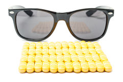 Stack or pills and sunglasses Royalty Free Stock Image